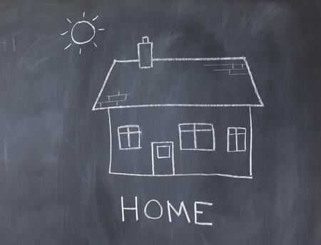 Big house and sun on a blackboard photo