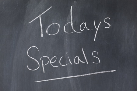 Blackboard with words todays specials written on it photo