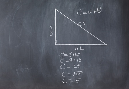 Right triangle with pythagorean formula and calculations on a blackboard photo