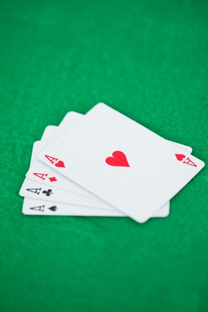 Poker aces on a green background Stock Photo - 26718581