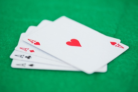 Poker cards on a green playmats Stock Photo - 10205481