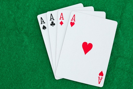 Playing cards on a poker mats Stock Photo - 10207240