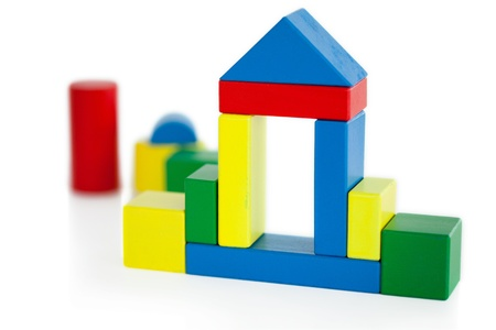 House built out of wooden toy on a white background photo