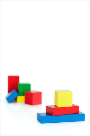 Childrens wooden blocks on a white background photo