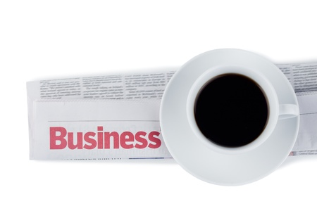 Folded newspaper and cup of coffee on a white background photo
