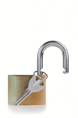 Open padlock with key on a white background photo
