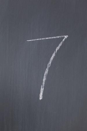 Blackboard with 7 written on it photo