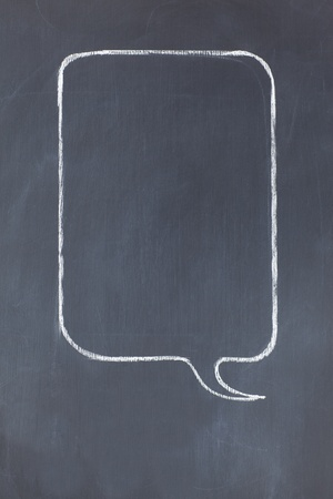 Empty rectangular speech bubble on a blackboard photo