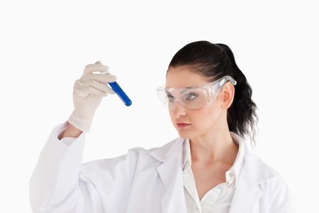 Dark-haired scientist carrying out an experiment in a lab photo
