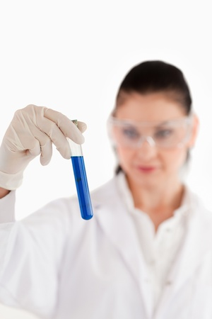 Isolated dark-haired scientist conducting an experiment in a lab photo