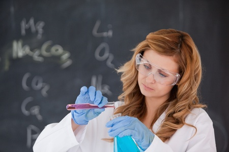 Blond-haired scientist conducting an experiment in a laboratory Stock Photo - 10206888