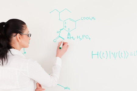 Scientist writing a formula on a white board photo