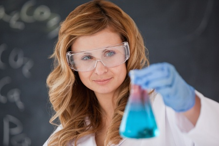 Attractive female scientist carrying out an experiment in a laboratory photo