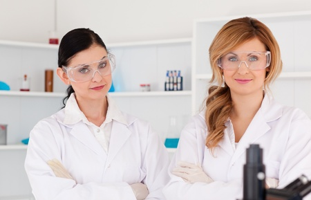 Two scientists posing in a lab photo