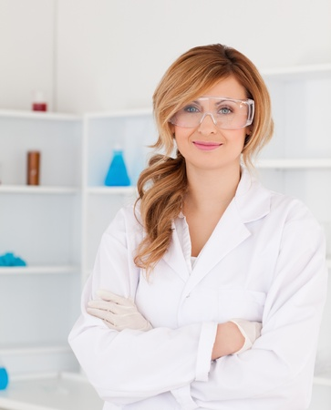 Cute blond-haired scientist posing in a lab photo