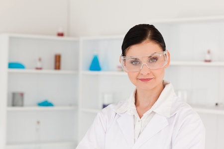 Dark-haired woman posing in a lab photo