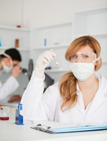 Scientists conducting an experiment in a lab photo