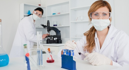 Two women looking at the camera in a lab Stock Photo - 10198242