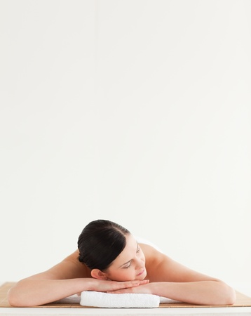 Cute dark-haired woman getting a spa treatment lying down photo