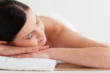 Beautiful dark-haired woman getting a spa treatment lying down photo