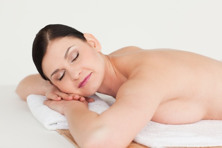 Cute dark-haired woman relaxing in a spa centre photo