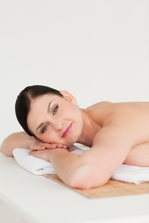 Attractive dark-haired woman relaxing in a spa centre photo