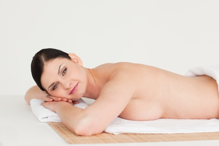 Pretty dark-haired woman relaxing in a spa centre photo