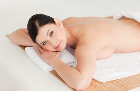 Pretty brunette relaxing in a spa centre photo