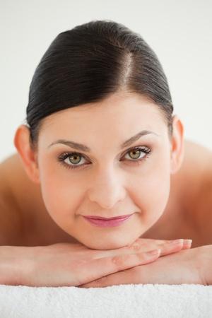 Beautiful brunette getting a spa treatment lying down photo