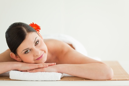 Attractive dark-haired woman getting a spa treatment lying down photo