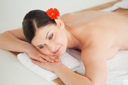 Pretty dark-haired woman getting a spa treatment lying down photo