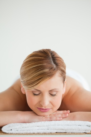 Blond-haired woman relaxing in a spa centre photo