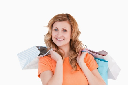Blond-haired woman showing her shopping photo