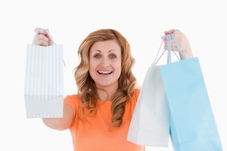 Happy blond-haired woman having done her shopping photo