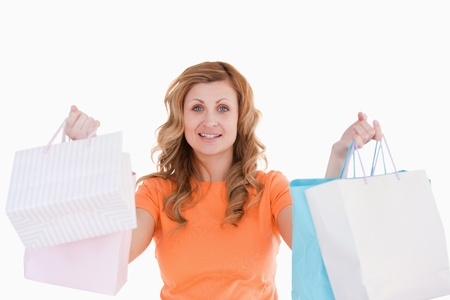 Cute blond-haired woman showing her shopping photo