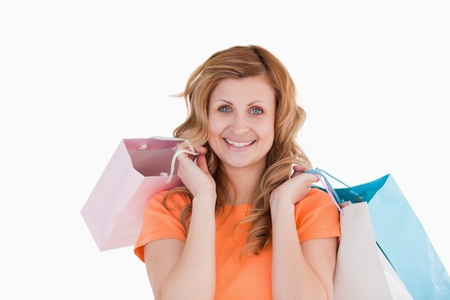 Happy blond-haired woman showing her shopping photo
