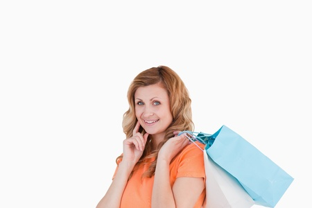 Lovely blond-haired woman showing her shopping photo