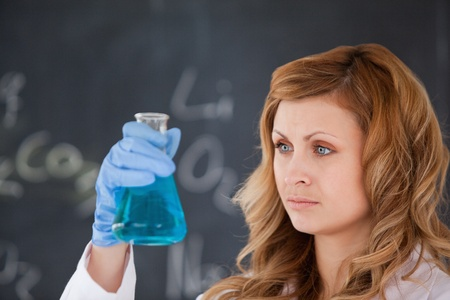 Cute female scientist conducting an experiment in a laboratory Stock Photo - 10207033