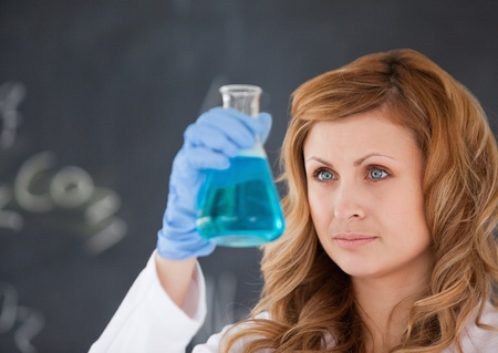Cute female scientist carrying out an experiment in a laboratory photo