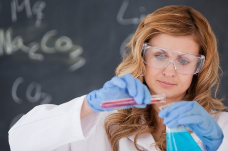 Young female scientist carrying out an experiment in a laboratory photo