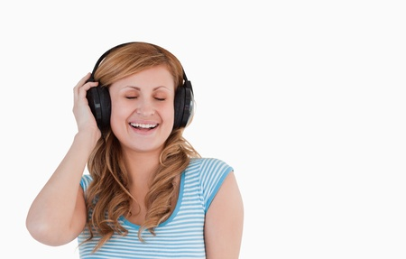 Isolated woman listening to music standing on a white background photo