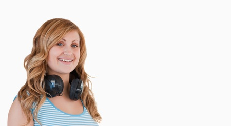 Isolated blond-haired woman posing with her headphones around her neck Stock Photo - 10194229