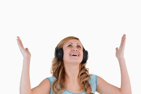 Isolated blond-haired woman enjoying while listening to music and watching towards the sky Stock Photo - 10194730