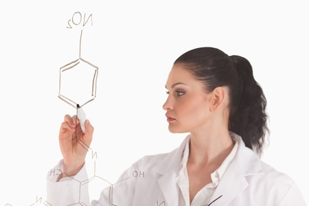 Isolated woman writing a formula on a white board in a lab Stock Photo - 10194287