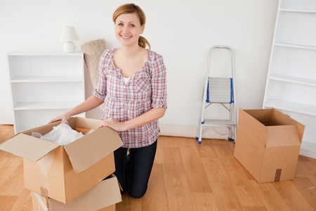 Young blond-haired woman preparing to move house  photo