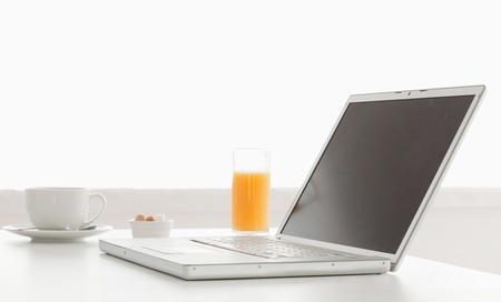 Stylish and modern laptop on a table in the kitchen photo
