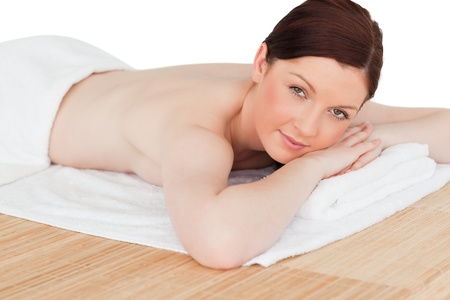 Cute red-haired female relaxing in a spa centre photo