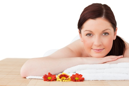 Portrait of a good looking red-haired woman posing while relaxing in a spa centre photo