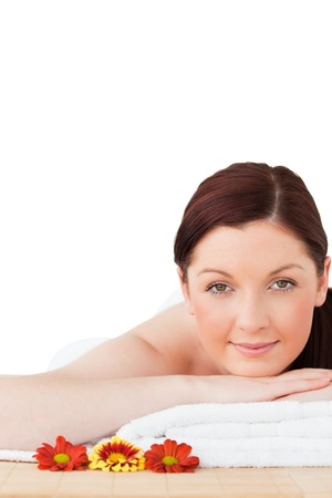 Portrait of a gorgeous red-haired woman posing while relaxing in a spa centre photo