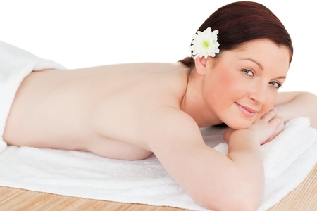 Portrait of a calm red-haired woman posing while relaxing in a spa centre photo